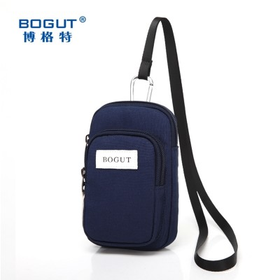 Boggarts 5.5 inch mobile phone package chest pack a man wearing a belt pocket multifunctional leisure bag wrist arm.
