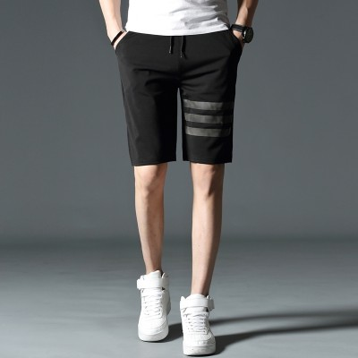 The summer male sports shorts in summer five stamp breeches loose beach big pants pants men's summer tide