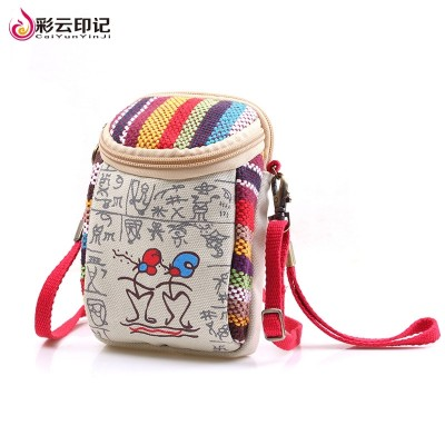 Cartoon Dongba zero wallet fabric mobile phone bag, cute female hand bag, mini canvas bag, multi-function