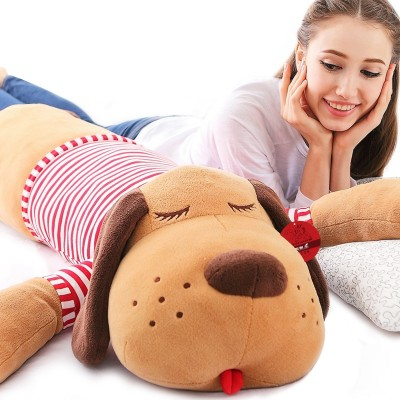 Stuffed toy dog, baby girl's birthday present sleeping on the pillow