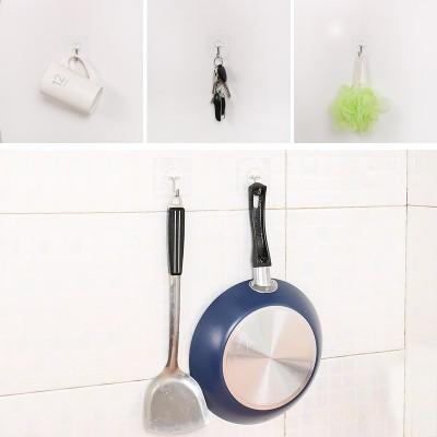 The hook hook is attached to the bathroom door behind the bathroom door