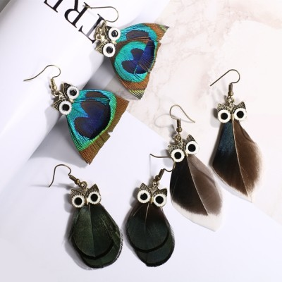 YiCai guardian elves peacock feather owl temperament fashion jewelry earring in the Korean version ear stud earrings earrings