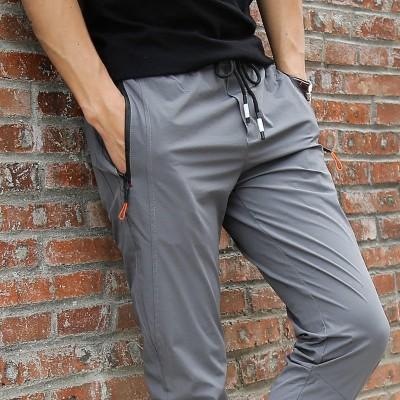 Sports pants, men's summer pants, thin casual pants, slim feet, quick drying, breathable slacks, men, Xia Kuzi